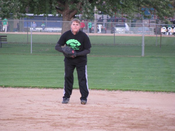 Jen playing softball concentrating
