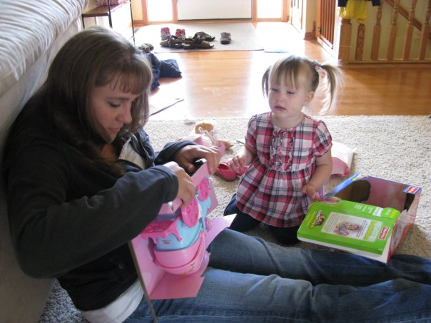 Jen helping gracie on her birthday